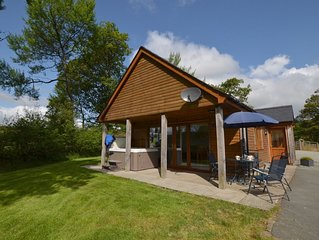 This quality lodge with hot tub offers seclusion, countryside views and a cosy i