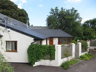 Former 13th Century milking parlour converted to stunning modern cottage