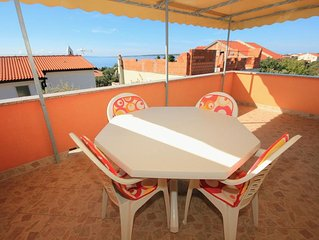 One bedroom apartment with terrace and sea view Mandre (Pag) (A-9354-c)