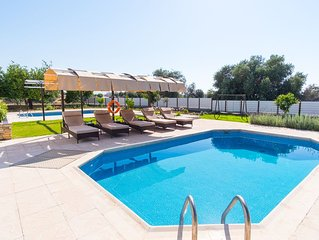 Villa with private pool and large balcony with sea view, ideal for families.