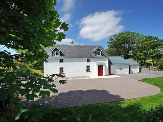 Traditional detached cottage in idyllic location beside tidal inlet and ¼ mile f