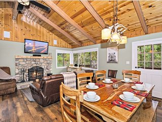 hot tub + pet friendly+ 2 bbqs+ decks with tree views+ cable+ master suite!