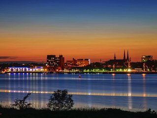 Scenic signature waterfront stay overlooking Charlottetown's  harbour and city.