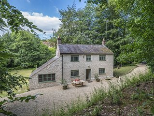 This cottage is located in its own magical woodland setting near Stoke Abbot.