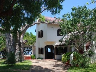 Kenyan family villa with beautiful  pool, private beach access, stunning views.