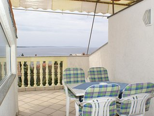 One bedroom apartment with terrace and sea view Mandre (Pag) (A-4098-a)