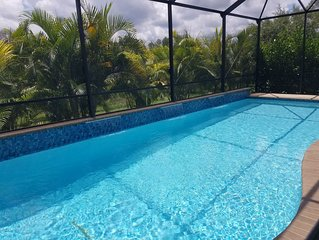 Unwind and Stay Awhile in a 3 Bedroom, 2 Bathroom, Heated Saltwater Pool Home