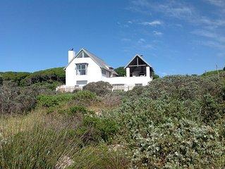Oystercatcher Beach House in de duinen van Kaap de Goede Hoop