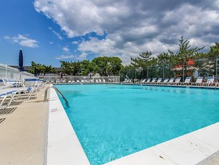 JUST 2 BLOCKS FROM THE BEACH AND STEPS TO THE POOL AND TENNIS COURTS