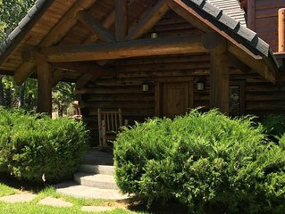 Story Book Log Home on 10 Private Acres