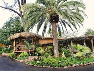Surrounded by waterfalls, lush gardens, hammocks and full pool/bar-b-q area.