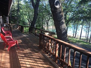 Lake side house with 1000 sq/ft of decking with unobstructed view of the water.