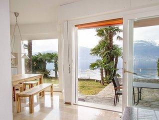Lakeside villa with direct lake access, boat mooring & short walk to restaurants