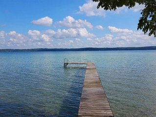 TORCH LAKE SW SIDE COTTAGE