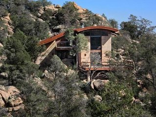 This incredible home is nestled in the boulders and sits atop a hill for incredible views in every direction.