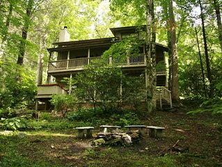 Dogwood Creek...A charming creekside 3-level home.