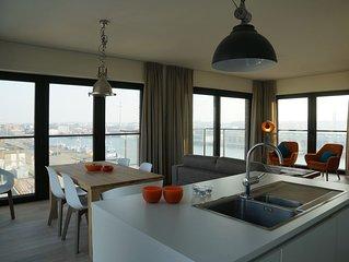 Gloednieuw appartement met zicht op de kaai, dicht bij strand en zee te Oostende