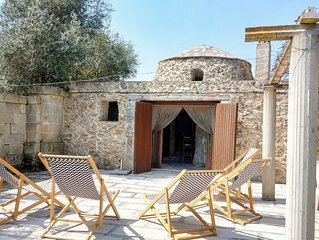 Hidden among olive trees, romantic beach 'trullo' short walk from the Ionian sea