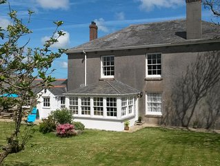 Cottage with large private garden, surrounded by farmland. Family & dog friendly