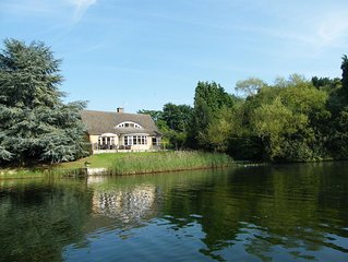 Luxury Lakeside Home In extensive grounds with boats, canoes and tennis court.