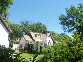 Ferienhaus 'Am Brunnen' mit privatem Whirlpool, Kamin, Garten