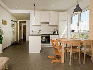 Helles und ruhig gelegenes 4-Sterne-Apartment mit großem Garten und Tiefgarage