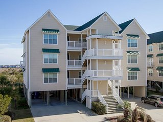 Vacation in this tranquil coastal condo minutes from the sand & sound of OIB!!