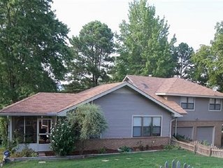 Central to all Hot Springs, 2 master suites, 2 story deck with Hot Tub