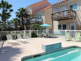 Spacious Condo w/ pool, private patio, boat slip, and close to the beach!