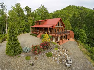 Secluded log cabin with mountain views, fireplace & wrap-around porch!