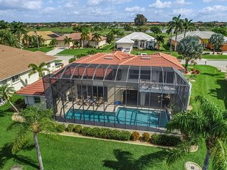 Spacious, waterfront home w/ a dock, heated pool, & spacious lanai