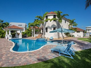Elegant, Waterfront Home w/ Private Pools & Hot Tub and Dock - Walk to Beach!