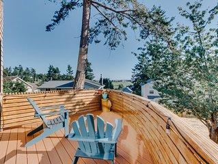 Bright island home w/ a mountain view, shared pool, & beach access