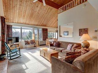 Bright condo with shared pool, sauna, & hot tub, close to skiing