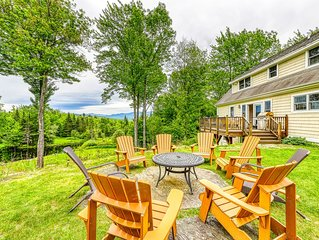 Ideally situated home w/ a furnished deck, stunning views, &  pond