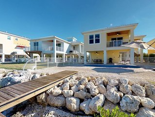 Family canalfront home w/ private pool, dock, gas grill & balcony - 1 dog OK!