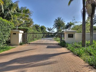Retro Chic Beach House - gated and private, bluff top, ocean located just below!
