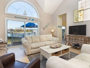 Waterfront townhome w/deck, sunroom, amazing bay view & shared pool