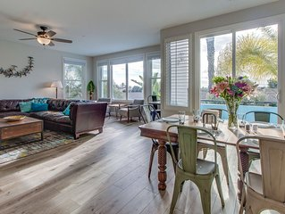 Sleekly styled condo with oceanview rooftop patio, short drive to beach!
