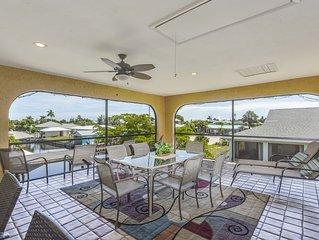 NEW LISTING! Spacious duplex-style condo w/enclosed patio & water views