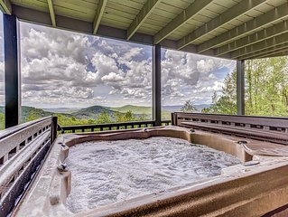 Mountain view cabin w/ private hot tub, wraparound deck, & fireplace!