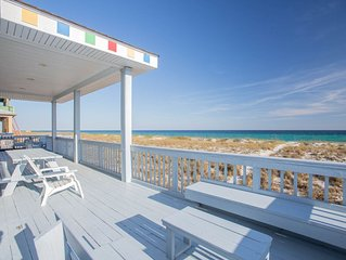 Step out onto the gorgeous white, sandy beaches from the deck of this home!