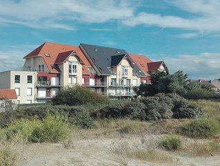 Appartement face mer, vue dune, clair, calme, 2 chambres, parking, ascenseur.