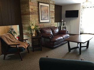Leather sofa and love seat TV games DVR and cozy seating in our living room