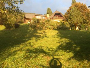 Beautiful house near lake, with panoramic view of Alps, set in large garden.