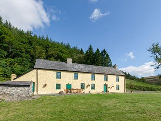 Large character farmhouse nestled on a hillside in the heart of rural Mid Wales