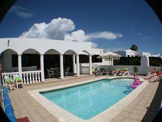 4 Bedroom, 3 Bathroom,  Heated gated Pool, 10 mins walk to beach, restaurants