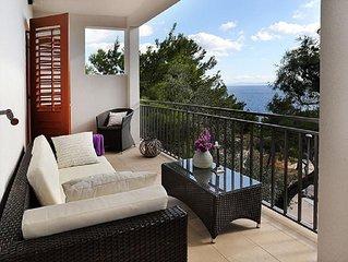 Two bedroom apartment with terrace and sea view Sveta Nedilja (Hvar) (A-17139-d)