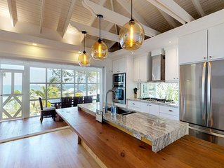 Waterfront home w/ infinity pool overlooking the ocean, dock, grill area, & gym