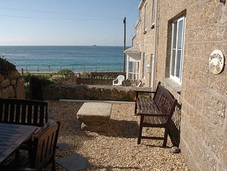 Family seaside cottage with fantastic sea views just 1 minute from the beach